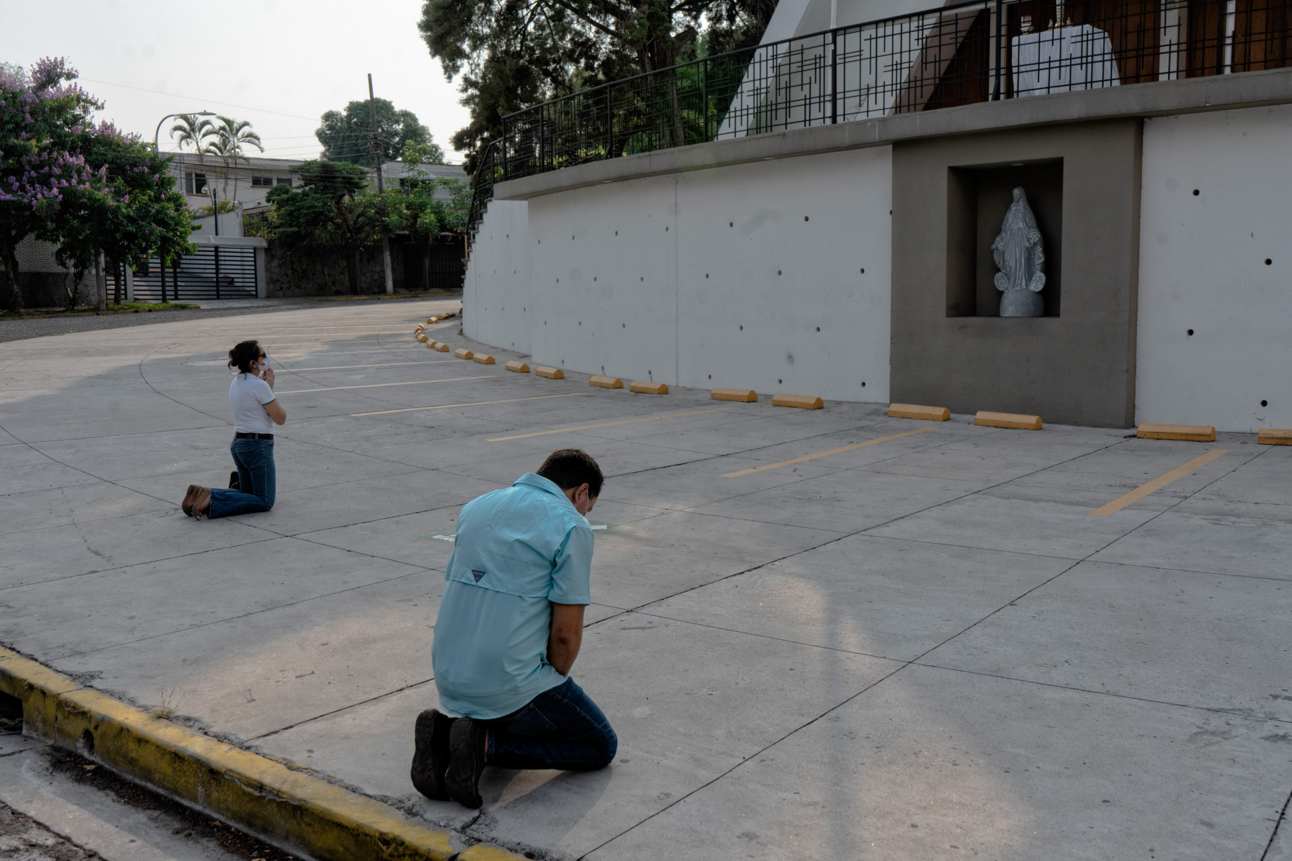 Catholic faithfuls pray outside of a church