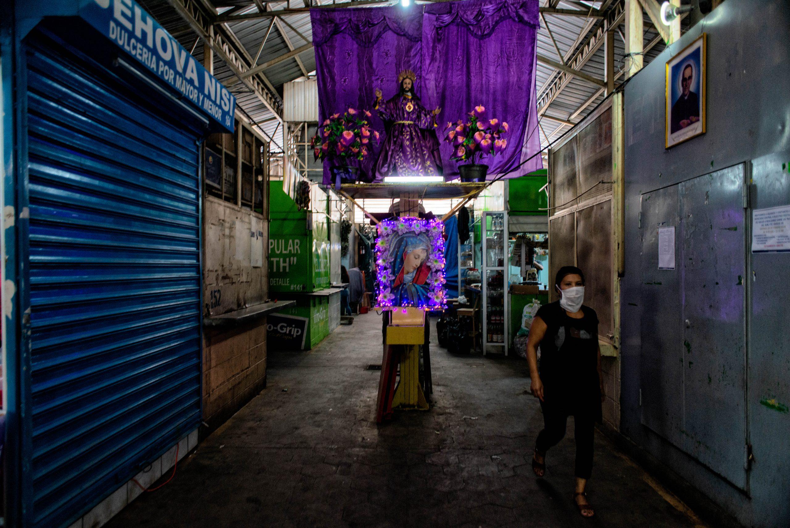 A customer passes a religious altar