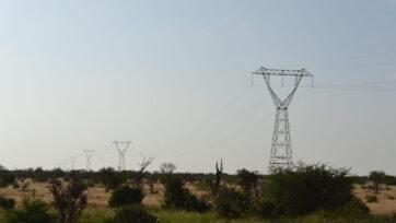 Electric_power_transmission_line_towards_the_south-east_in_the_Tsavo_East_National_Park,_Kenya_2