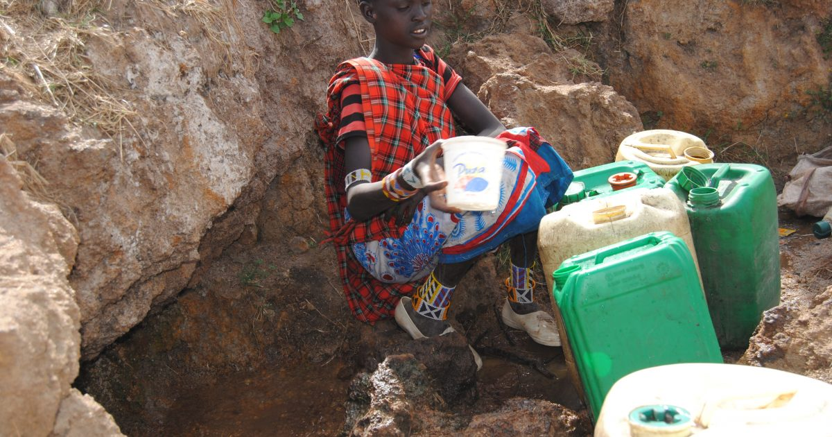 Maasai girl fetching water from a cave