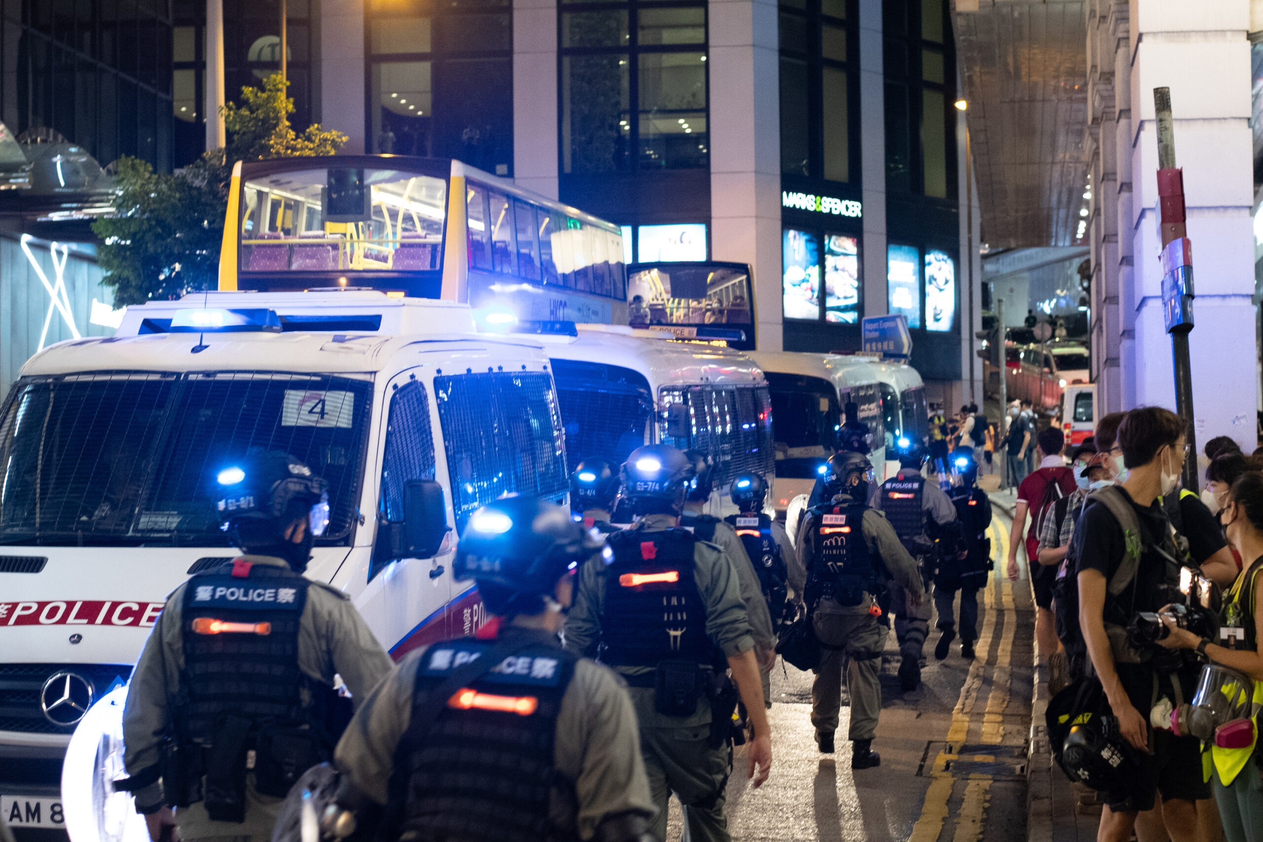 THE WAY WE LIVE NOW: Hong Kong police squash dissent in display of China's muscle