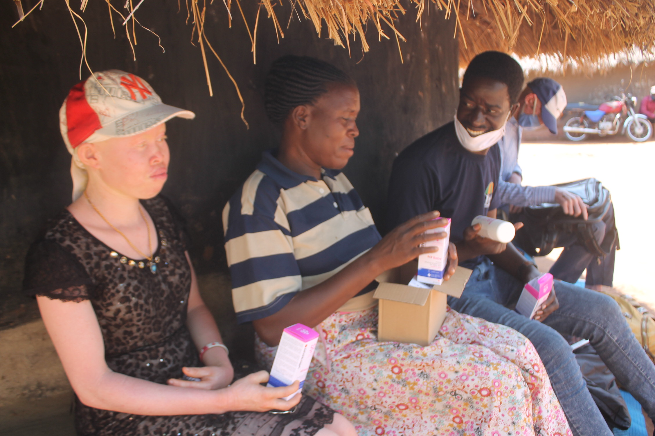 Motorbike mission: Activist delivers sunscreen to albinos
