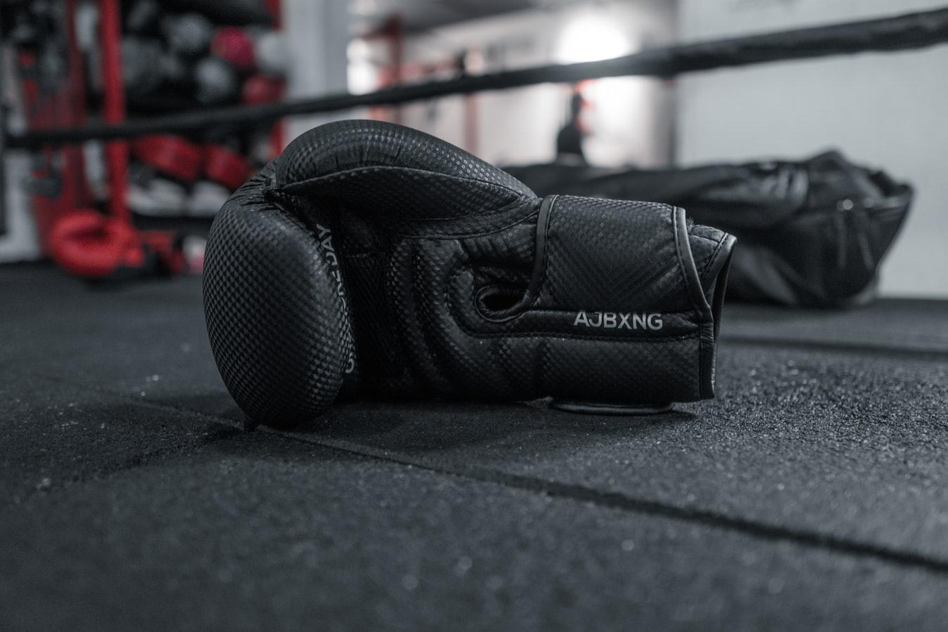 Boxing gloves in ring Prateek Katyal Unsplash
