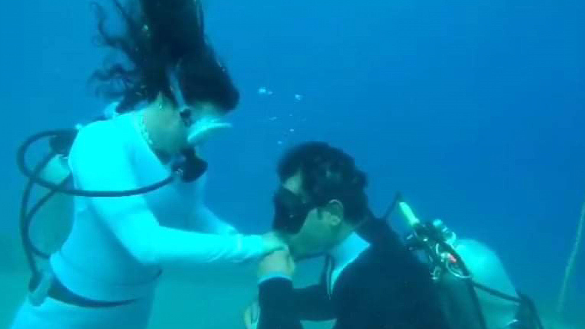 Taking the Plunge: Champion Diver Proposes Underwater, With Social Distance