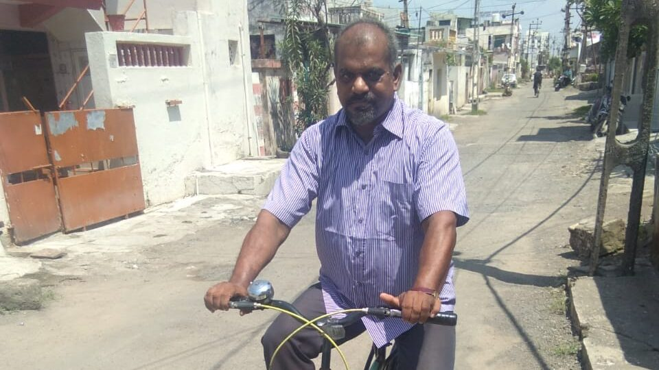 Indian Priest Pedals to Parishioners' Homes During the Lockdown