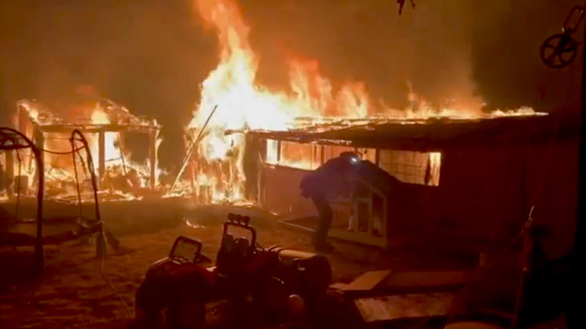 VIDEO: U.S. Firefighters Battle Blaze Threatening Trucks