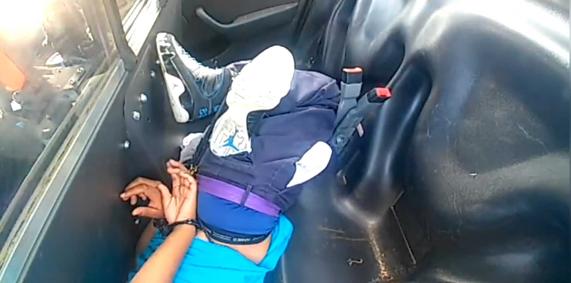 Cop Leaves Screaming Black Woman Face Down in Back-Seat Footwell