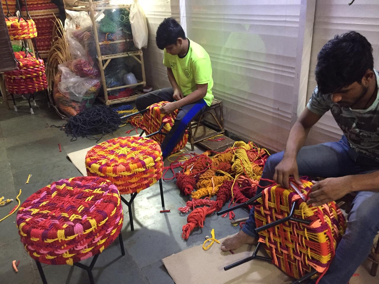 Workmen working on ottomans made from waste ropes
