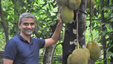 James Joseph next to Jackfruit tree - Photo Courtesy James Joseph