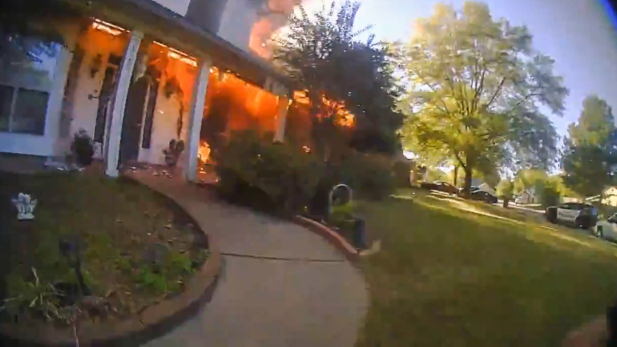 Police Officer Runs into Burning Home to Save Couple and Their Dog