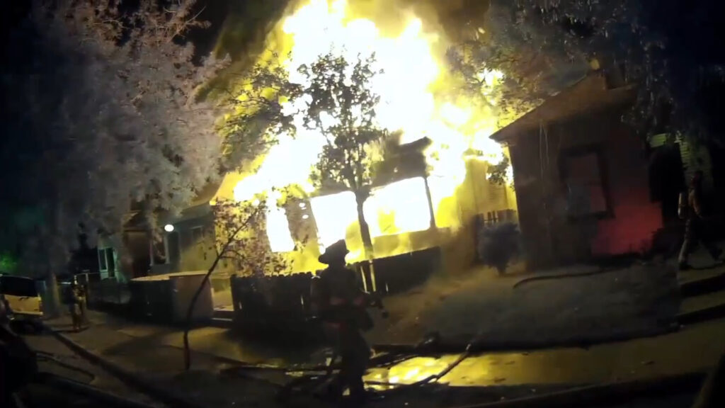 California Firefighters Battle Spreading House Fire At Vacant Home