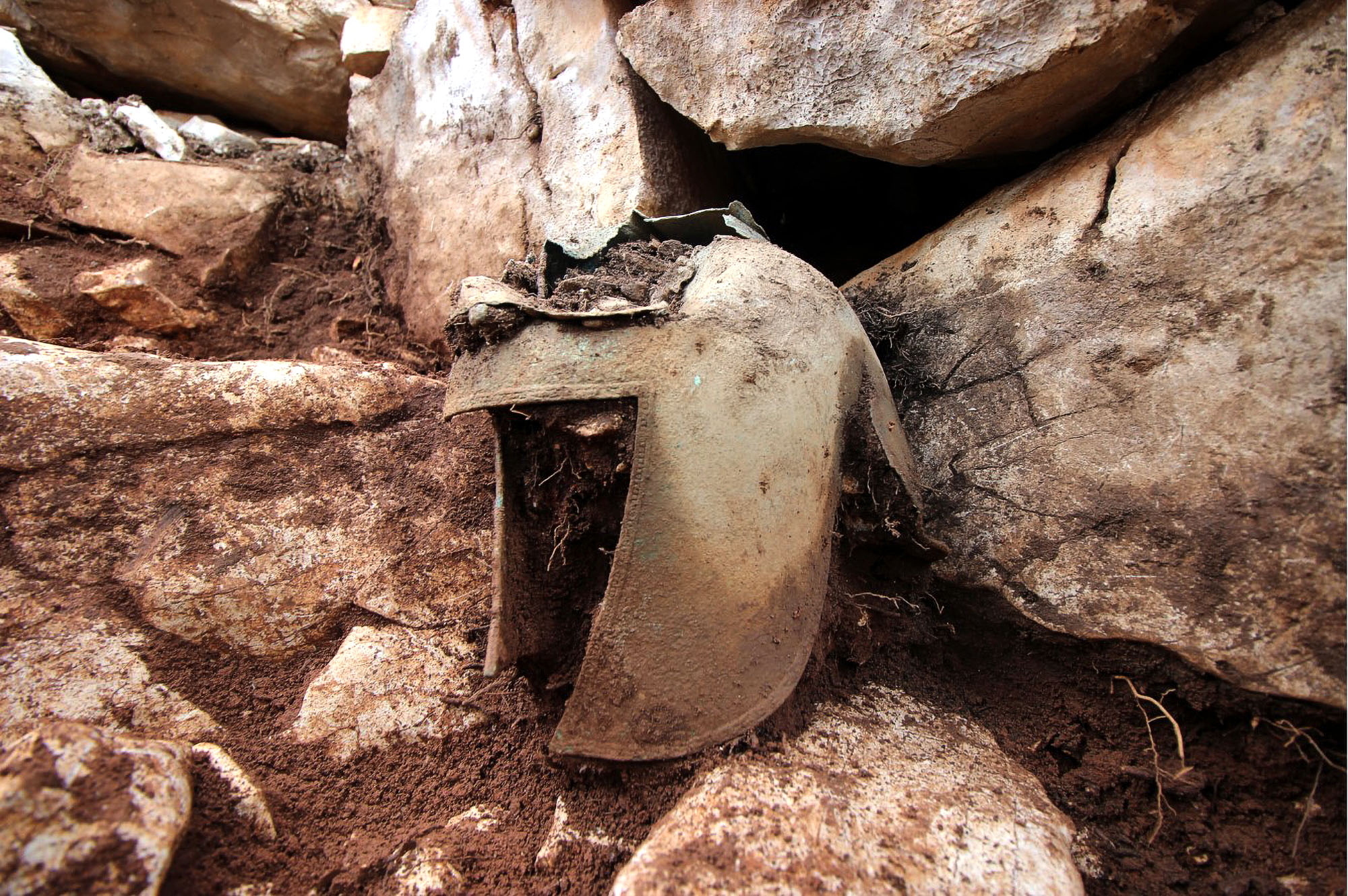 VIDEO: Scientists Find Ancient Greek Warrior Buried With His Helmet On