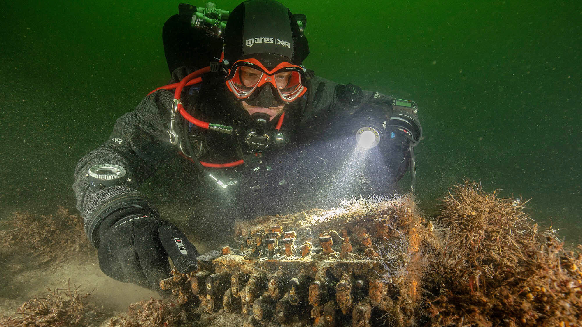 Rare Nazi Enigma Code Machine Found by Divers Collecting Used Fishing Nets