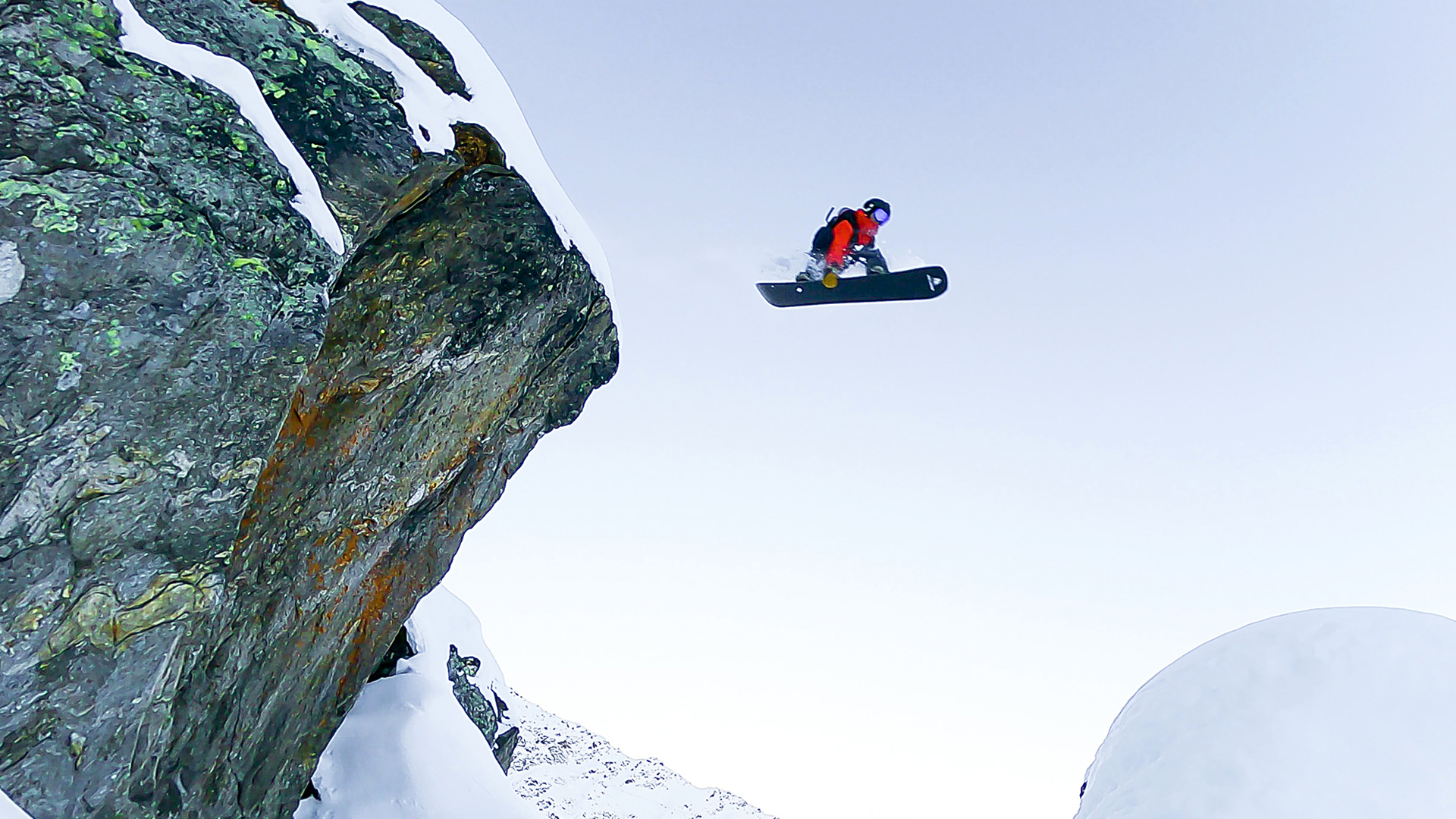 VIDEO: Fearless Snowboarder Takes on a Ridge Too Far