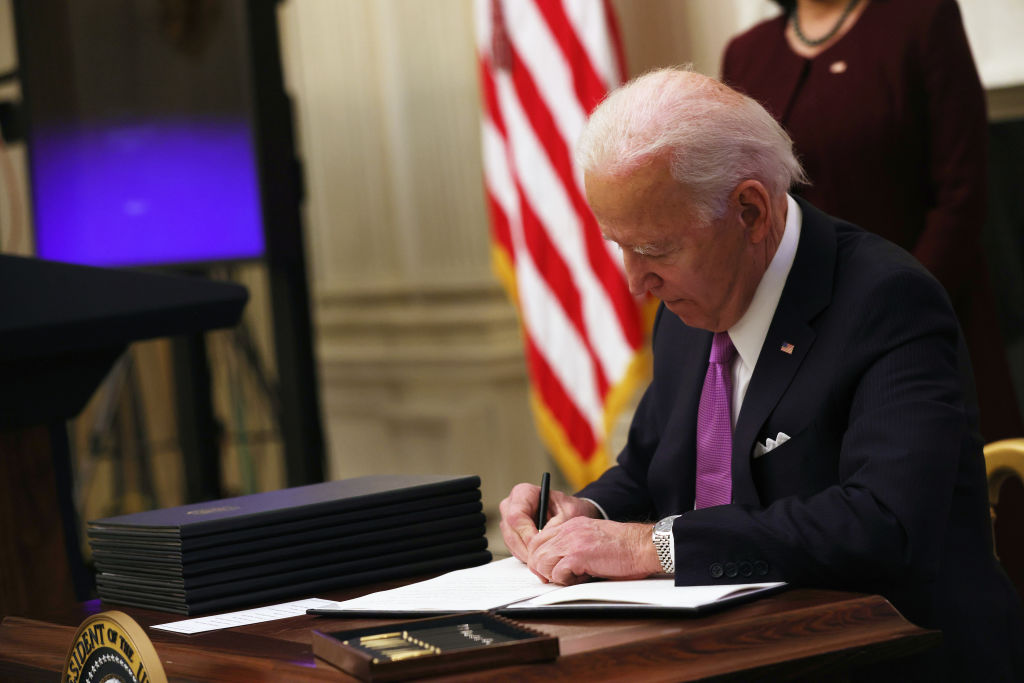 In First Executive Orders, Biden Makes Clear Break With Trump Era