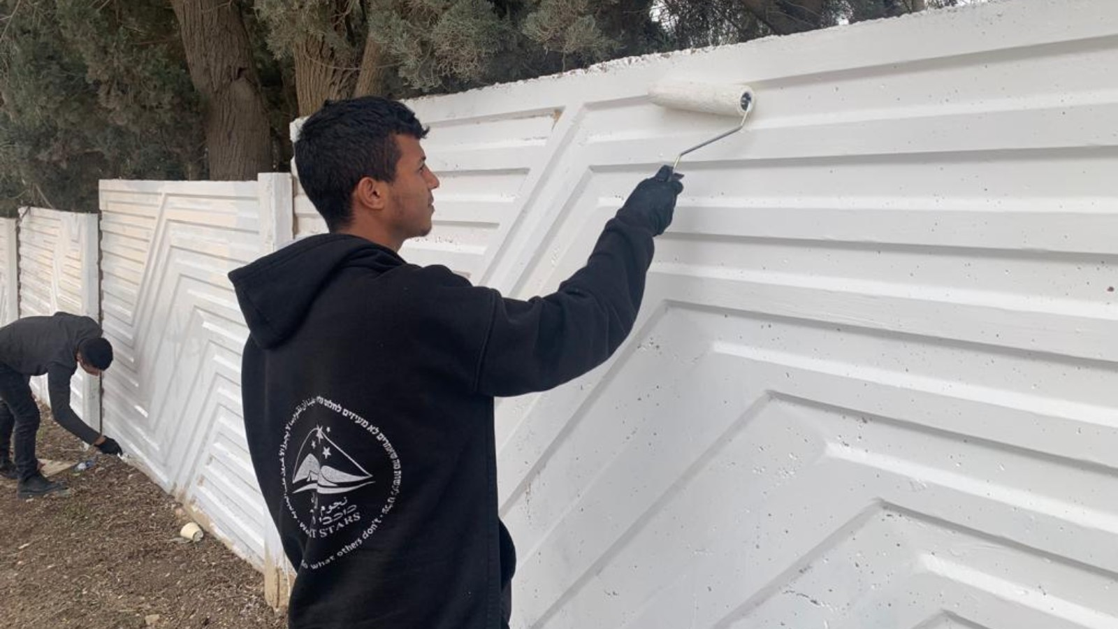 Muslim Volunteers Fix Vandalized Jewish Graveyard