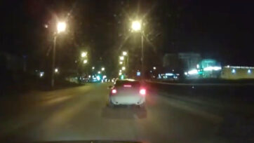 VIDEO: Russian cops chased and hoped into the moving drunken driver's moving car.