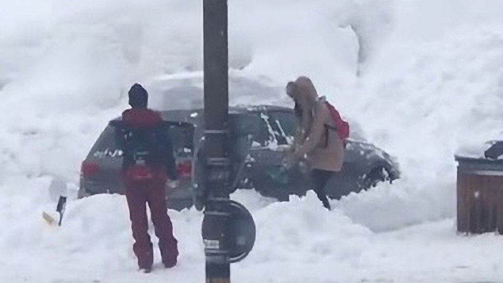 Man Ridiculed For Watching Woman Dig Her Car Out of Snowdrift