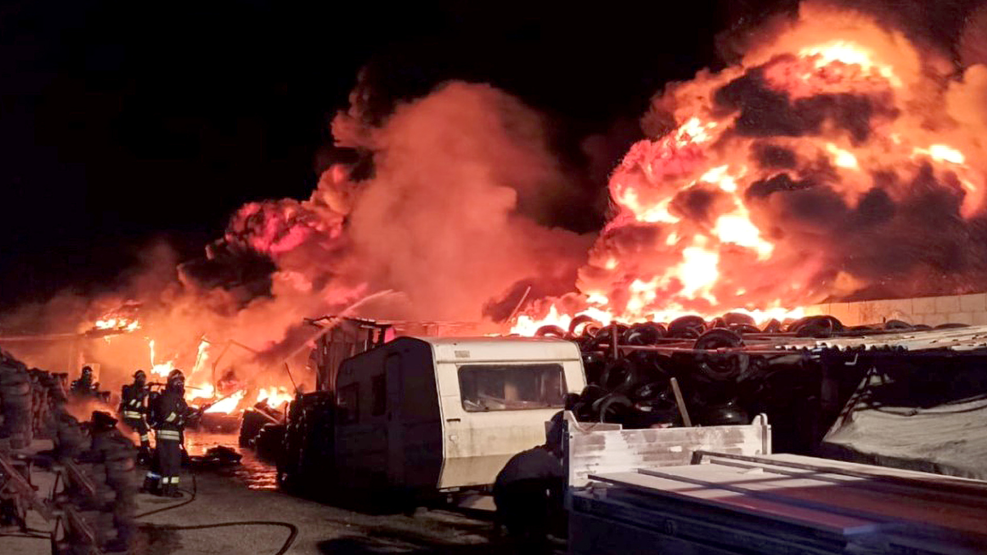 VIDEO: Firefighters Evacuate Town As Fire Rips Through Tire Warehouse In Italy