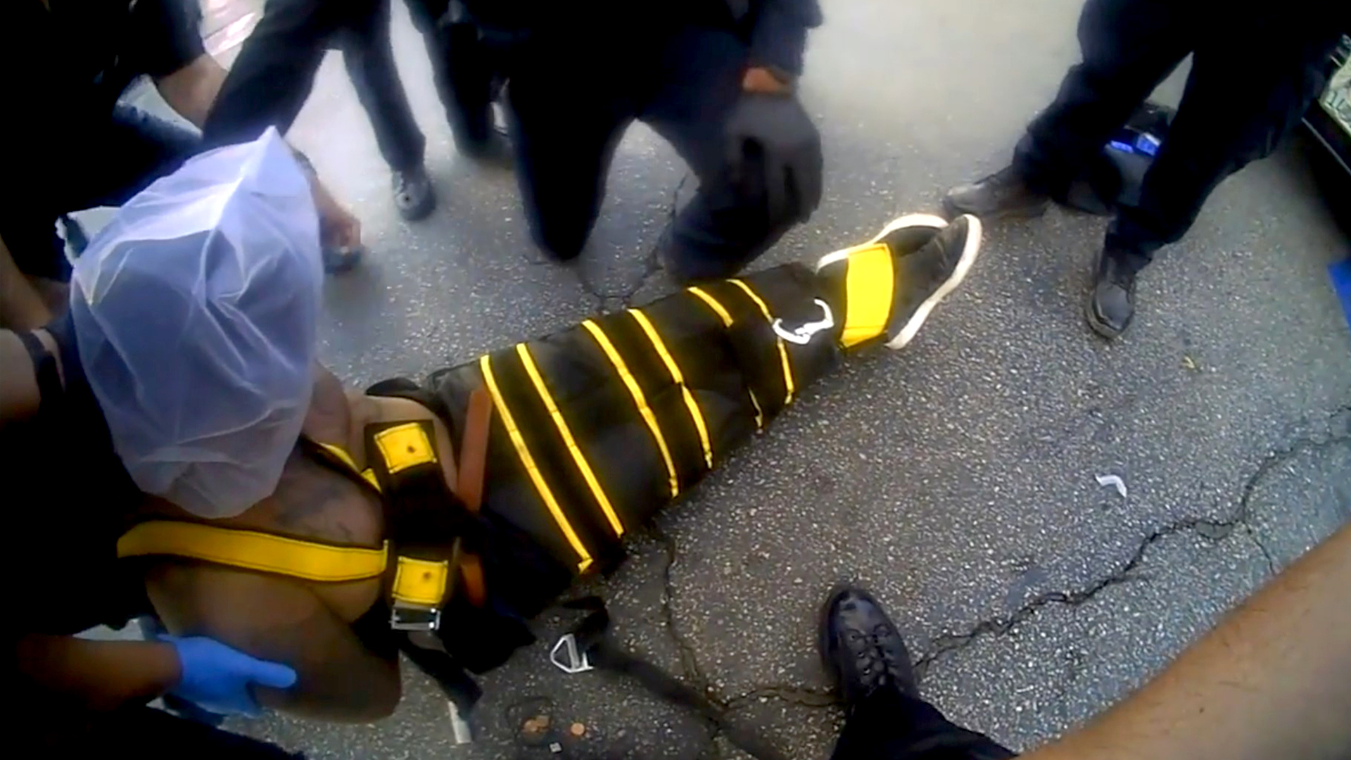 VIDEO: Six Laughing Police Pinned Hooded Suspect To The Ground As He Choked To Death