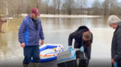 VIDEO: Family Rescues Cats From Flooded Home On Inflatable Raft