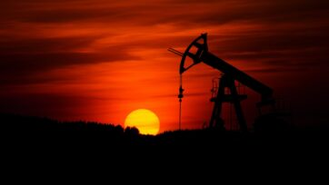 Oil pump (pumpjack) and sunset