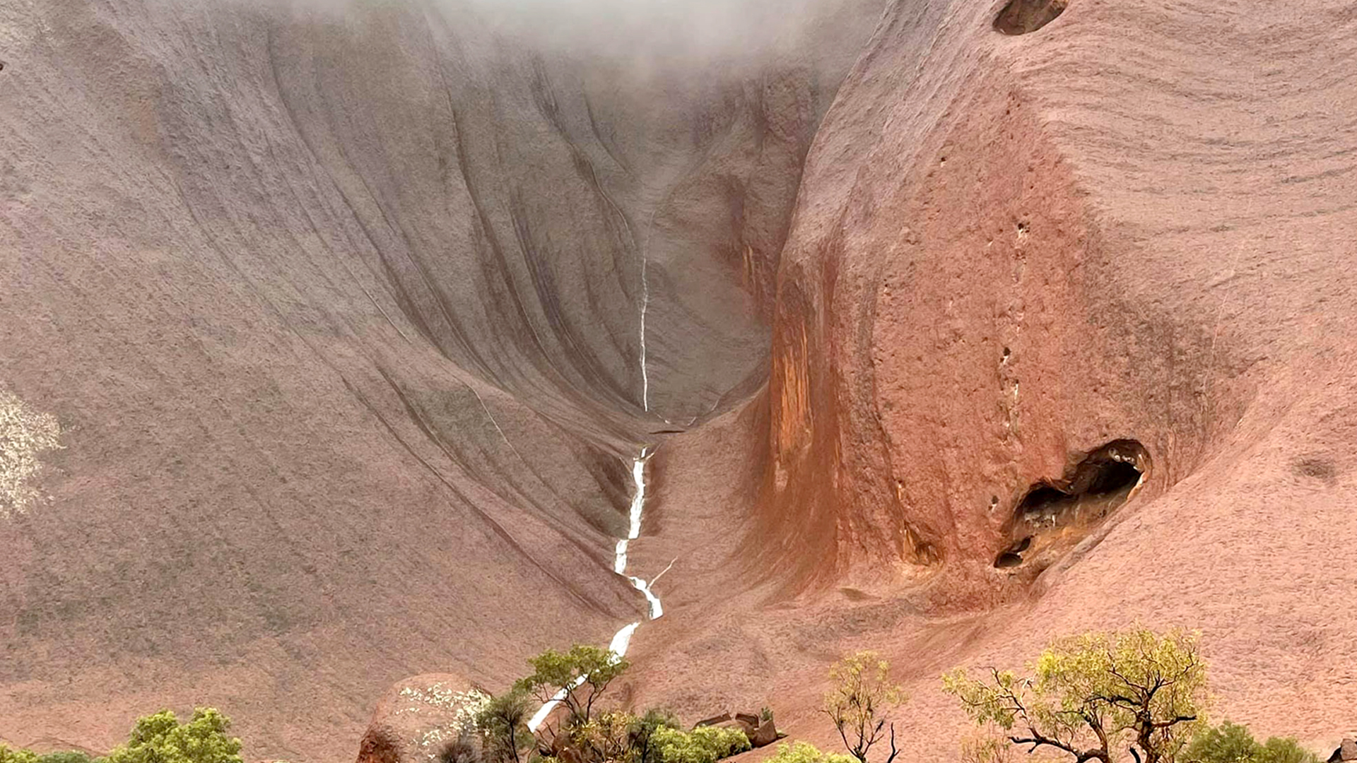 VIDEO: Sight For Sore Ayers: Stunning Rain Waterfalls Gush Down Uluru's Slopes