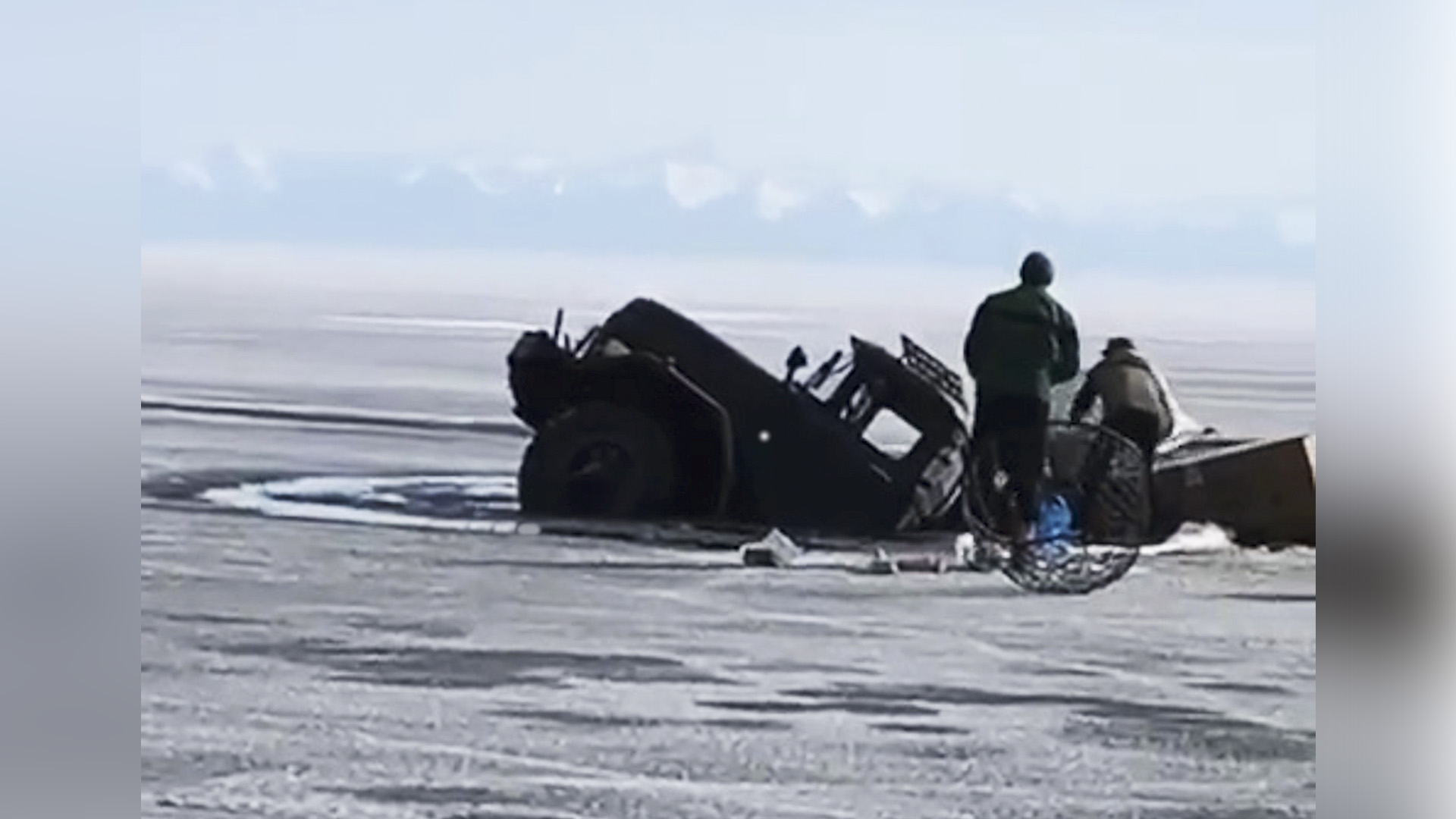 VIDEO: Ice Load Truckers: Army Six Wheeler Swallowed By Massive Frozen Lake