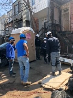 <p>HTP Homes trainees gather to map out a work plan on a vacant home in Baltimore. (Courtesy of HTP Homes)</p>