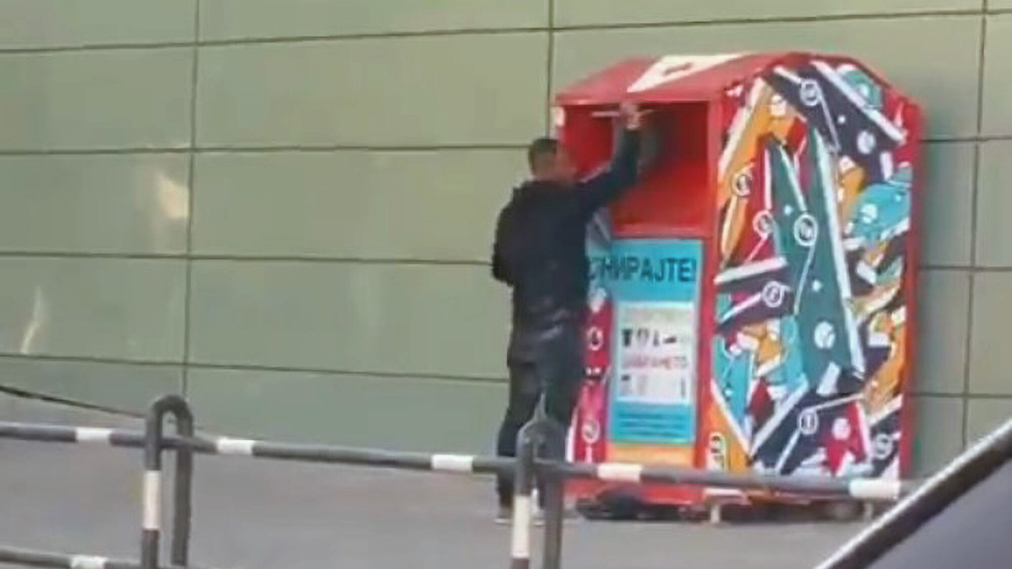 VIDEO: Self Service: Man Filmed Pushing Boy Into Charity Box For Needed Clothing