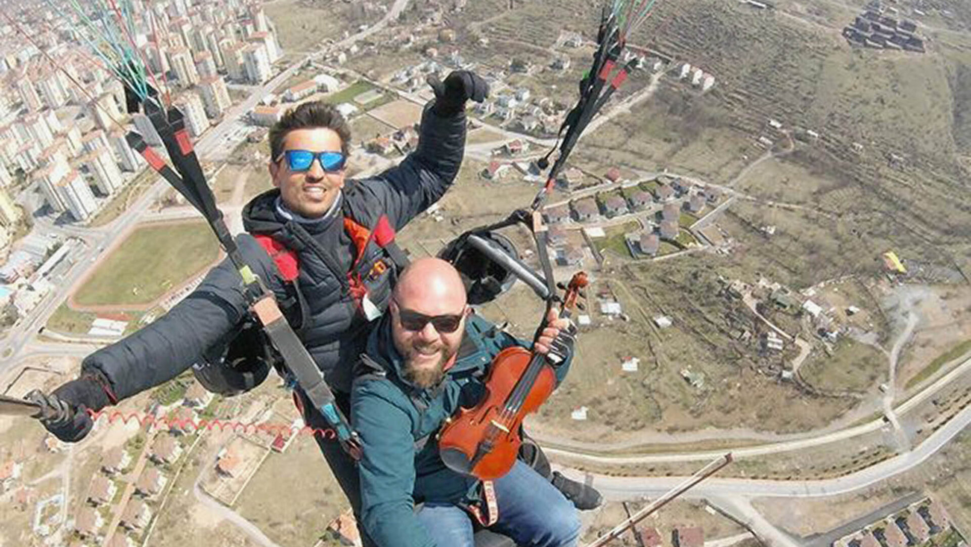 VIDEO: String And A Prayer: Nervous Paraglider Plays Violin To Soothe First Flight Nerves