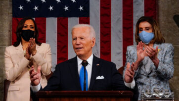 President Joseph R. Biden Jr. addresses a joint session of Congress on April 28, with Vice President Kamala D. Harris, left, and House Speaker Nancy Pelosi (D-Calif.) behind him in the House chamber of the U.S. Capitol. (Melina Mara-Pool/Getty Images)<br>