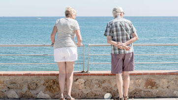 A couple enjoys the view from the promenade in Benalmadena, Spain. The country is among Europe's top destination for British expats. (David Ramos/Getty Images)