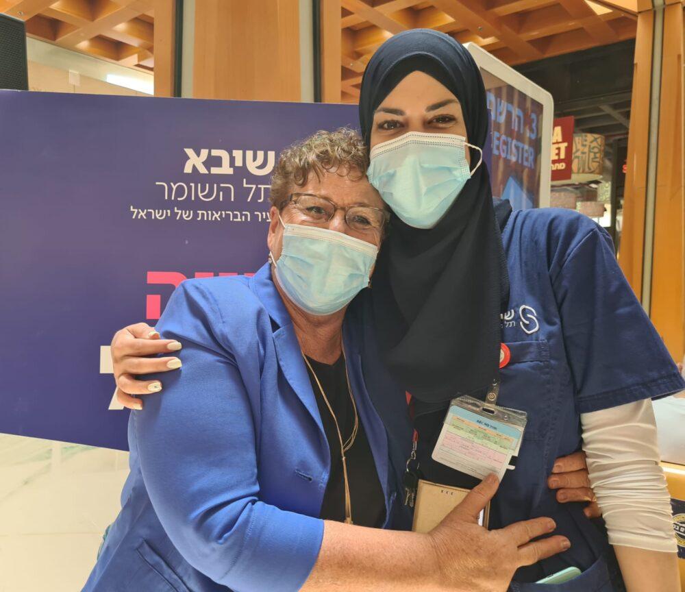 <p>Lena Ahmad with Miriam Peretz at Sheba Medical Center. (Naama Frank Azriel)</p>