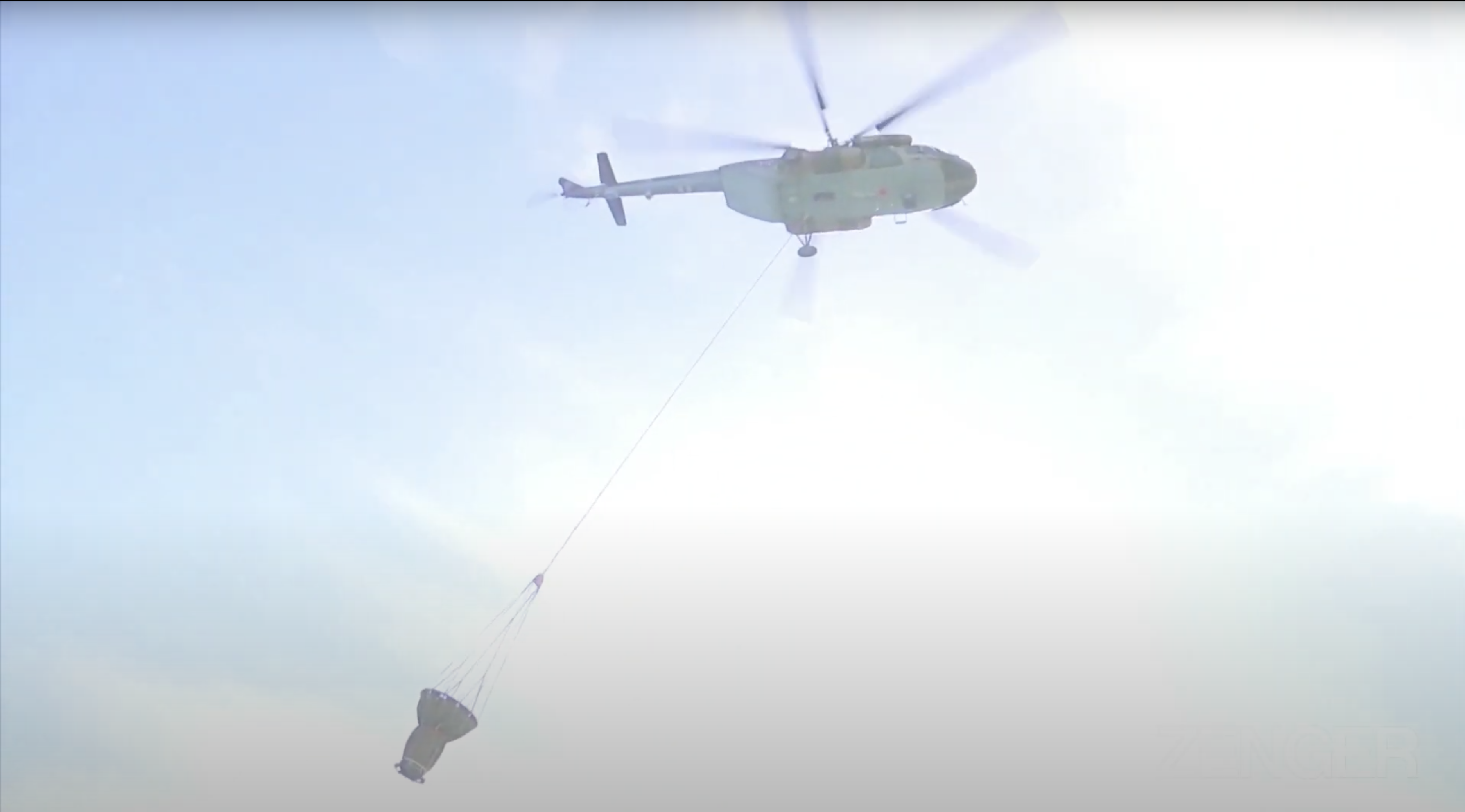 VIDEO: Military Helicopter Drops Massive Amount Of Water Onto Russian Fire