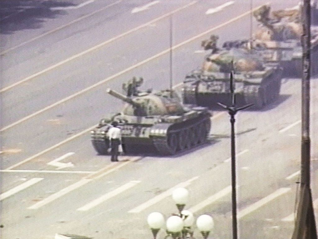 """A lone Chinese demonstrator (also known as """"Tank Man"""") stands down a column of tanks June 5, 1989 at the entrance to Tiananmen Square in Beijing, China. The incident took place on the morning after Chinese troops fired upon pro-democracy students who had been protesting in the square since April 15, 1989. Last Friday, on the 32nd anniversary of Tiananmen Square, images and videos of """"Tank Man"""" were taken down worldwide from Bing, Microsoft's search engine. Later, a Microsoft (MSFT) spokesman said they were taken offline """"by mistake"""" attributing the removal to 'human error.' The images reappeared on Saturday globally outside of China. (Photo by CNN via Getty Images)"""