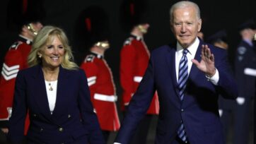 U.S. President Jospeh R. Biden Jr. and first lady Jill Biden arrive at Cornwall Airport in the UK on June 9, with an honor guard including members of the British Army's Guards regiments. The UK is his first stop on his first foreign tour. He is attending the G7 from June 11 and holding a summit with Russia's President Vladimir V. Putin in Geneva, Switzerland. (Jack Hill/WPA Pool/Getty Images)