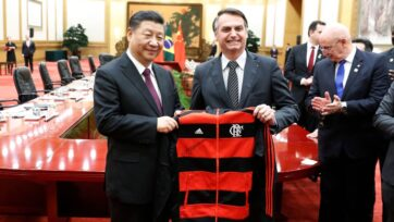 Brazilian president Jair Bolsonaro presents a leather jacket to Chinese Premier Li Kegiang in Beijing, China, before the pandemic broke out. China has invested even more in South America since COVID-19 hit the entire world. (Yukie Nishizawa/Pool/Getty Images)