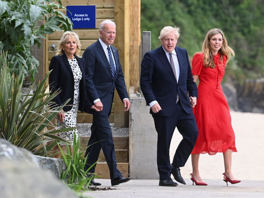 Britain's Prime Minister Boris Johnson, his wife Carrie Johnson and U.S. President Joe Biden with First Lady Jill Biden walk outside Carbis Bay Hotel, on June 10, 2021 near St Ives, England. UK Prime Minister, Boris Johnson, will host leaders from the USA, Japan, Germany, France, Italy and Canada at the G7 Summit that begins on Friday, June 11 2021. (Photo by Toby Melville – WPA Pool/Getty Images)