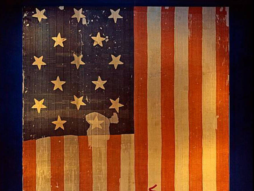 This original Star-Spangled banner currently hanging in Flag Hall of the National Museum of American History in Washington, DC, inspired Francis Scott Key and the words of our National Anthem after it was flown over Fort McHenry in 1814. President Joseph R. Biden proclaimed June 14, 2021, as Flag Day, and the week starting June 13, 2021, as National Flag Week and flag week. (Smithsonian Archives/History Div)