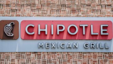 A Chipotle Mexican Grill sign is shown in Houston, Texas. Menu prices at the Chipotle Mexican Grill have risen by roughly 4% to cover the costs of raising its' minimum wage to $15 an hour for employees. The restaurant industry has been boosting wages in the hopes of attracting workers during a labor crunch. (Photo by Brandon Bell/Getty Images)