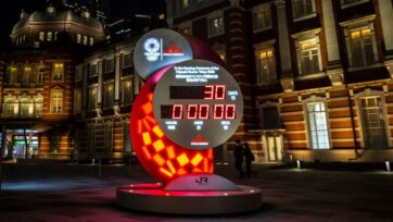 A countdown clock for the Tokyo Olympic and Paralympic Games is seen at night at Tokyo Station on the day marking 30 days to go until the Olympic games, on June 23, 2021 in Tokyo, Japan. Today marks one month to go until the start of the postponed Tokyo Olympics. With the Games delayed by one year because of Covid-19, concern continues to linger around the safety of holding such a huge event while much of the world remains in the grip of the coronavirus pandemic. (Photo by Yuichi Yamazaki/Getty Images)