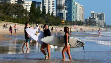 Queenslanders are being urged to take up the holiday vacancies left by mass cancellations from NSW.