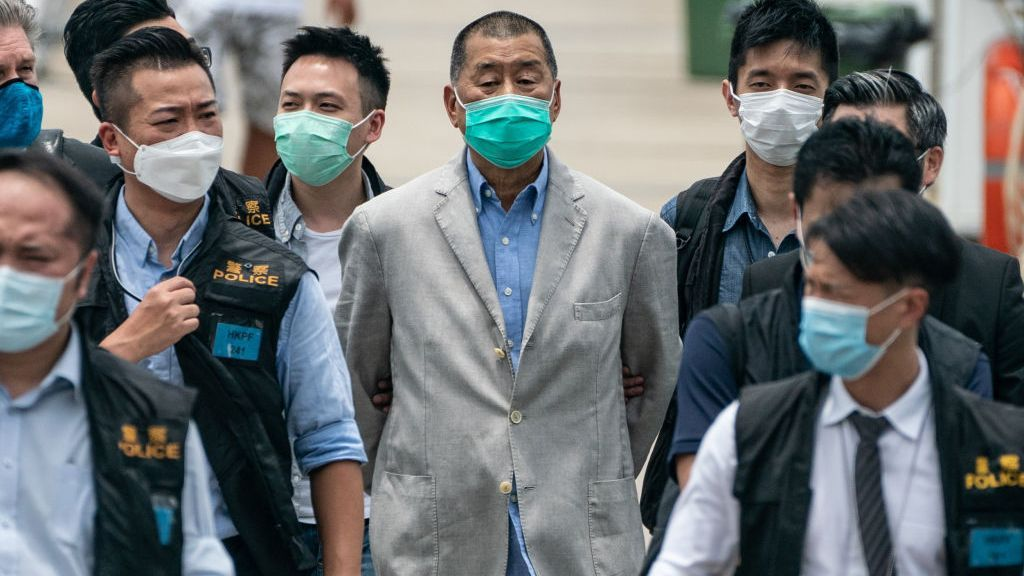 <p>Hong Kong media tycoon and Apple Daily founder Jimmy Lai (C) is escorted by a group of police to the Royal Hong Kong Yacht Club Shelter Cove Clubhouse for evidence collection on August 11, 2020 in Hong Kong, China. Lai was arrested, along with several of his family members and associates, for alleged collusion with foreign forces under the new national security law. (Photo by Anthony Kwan/Getty Images)</p>