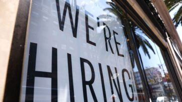 A 'We're Hiring!' sign is displayed at a Starbucks on June 23, 2021, in Los Angeles, California. The U.S. Bureau of Labor Statistics reported that 850,000 jobs were added to the economy in June. (Mario Tama/Getty Images)