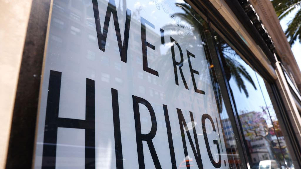 <p>A 'We're Hiring!' sign is displayed at a Starbucks on June 23, 2021, in Los Angeles, California. The U.S. Bureau of Labor Statistics reported that 850,000 jobs were added to the economy in June. (Mario Tama/Getty Images)</p>