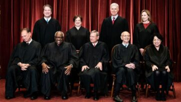 The nine justices prepare to pose for a group photo at the Supreme Court in Washington, D.C., on April 23. Seated from left: Associate Justice Samuel Alito, Associate Justice Clarence Thomas, Chief Justice John Roberts, Associate Justice Stephen Breyer and Associate Justice Sonia Sotomayor, Standing from left: Associate Justice Brett Kavanaugh, Associate Justice Elena Kagan, Associate Justice Neil Gorsuch and Associate Justice Amy Coney Barrett. (Erin Schaff-Pool/Getty Images)