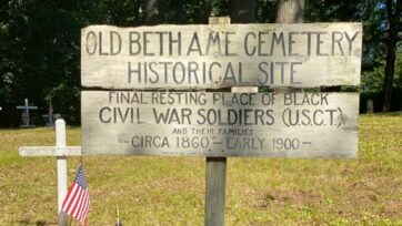 A sign marks the Squirrel Town cemetery, where an estimated 35 black Civil War veterans rest in peace. (George Willis)