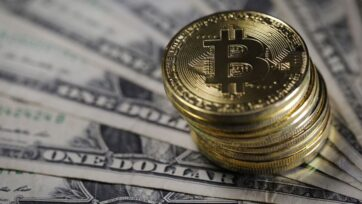 Under accounting rules, cryptocurrencies are considered intangible assets. A company records the value on its balance sheet at acquisition. But should there be an impairment—like a significant drop in value—the losses are written down on the balance sheet. (Photo by Dan Kitwood/Getty Images)