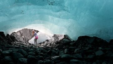 Emily Baker, a Geophysicist with the United States Geological Survey, walks past the mouth of an ice cave carved out underneath the Wolverine Glacier in the Kenai Mountains on September 06, 2019 near Primrose, Alaska. The USGS has has been studying the glacier since 1966 and the studies show that the worlds warming climate has resulted in sustained glacial mass loss as melting outpaced the accumulation of new snow and ice. As the glaciers melt, scientists are also trying to understand how that will impact the environment and the level of the water in the worlds oceans. (Joe Raedle/Getty Images)